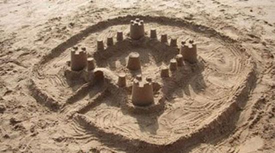castillo-playa-arena-clasico-4-torres