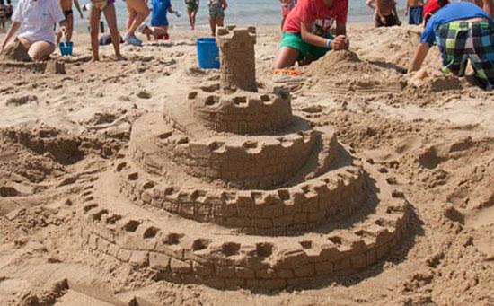 playa-castillo-arena-torre-murallas