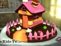 Nice cake with a chocolate house
